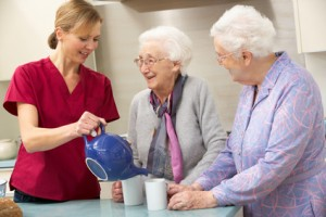 Senior women at home with caregiver