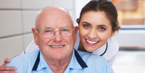 nurse and senior man smiling