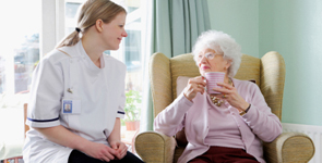 nurse chatting with senior lady