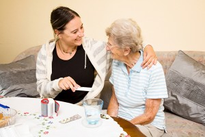caregiver helping senior with medications